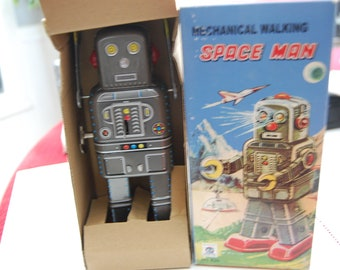 TIN TOY--Mechanical Walking Space Man - Must see- New in Box