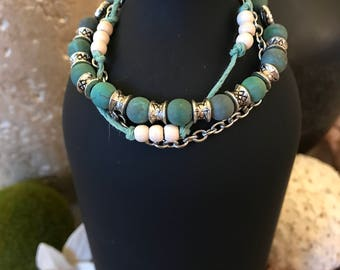 """Light green-turquoise multi strand bracelet.  Very unique lovely bracelet would look great with many outfits.  7 1/2"""" plus extender."""