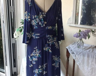 Beautiful ruched royal blue dress with delicate floral decoration