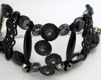 Carmen, all black textured elements, sparkling, magnetic closure, safety chain,  cuff style bracelet,  contemporary, sparkling