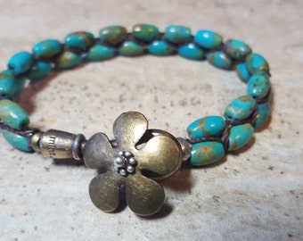 Turquoise,brass flower and hook bracelet