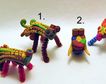 Ornaments. Giffer Bug ornaments with 4 characters to choose from. Small, fun bug creatures in bright colours with pipe cleaner legs.