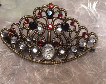 Queen of hearts alligator hair clip. Black gem hearts, clear gems and red gems on a crown.