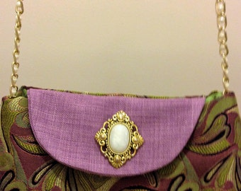 Small cross body bag with beautiful details