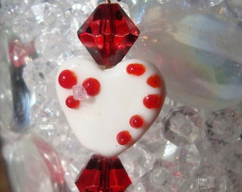 white glass lampwork heart earrings with red crystal accents