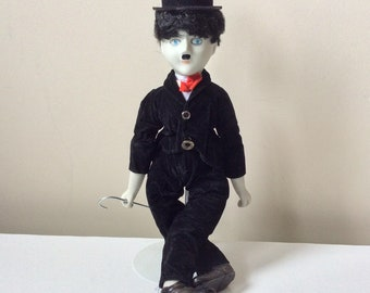 Charlie Chaplin porcelain doll on stand with stick