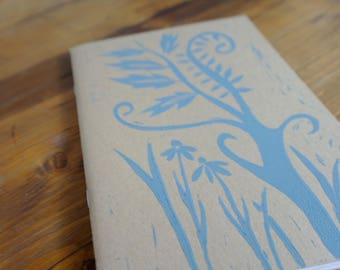 Handprinted flower and tree lino-cut notebook