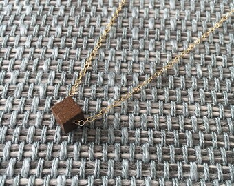 One wooden cube necklace