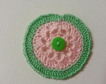 crocheted cotton green and pink flower