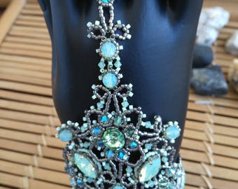 Eastern-inspired bracelet-ring and crystals and Swarovski crystals