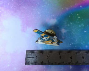 Vintage aircraft blue and yellow enamel pins