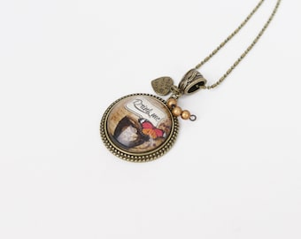 Necklace cabochon Drink me, cup and butterfly