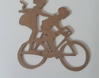 Silhouette of a boy and girl on a bike