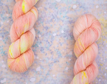 "Rad Sock - ""No Pink Lemonade"" - pale peach yarn speckled with neon yellow - fingering weight superwash merino wool"