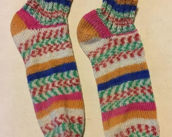 Checks and stripes! A festive pair of handknit ankle socks, a very soft self-striping yarn in smartwool.