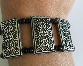 Black seed bead bracelet, elastic bracelet, stretch bracelet, pewter accent pieces