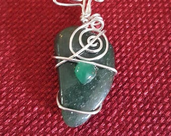 Silver wire wrap Moss agate.