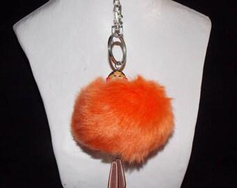 Key tassel representing a character