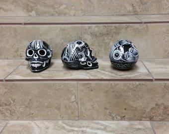 Ceramic sugar skulls. sugar skulls. handpainted sugar skulls. halloween decor. skeleton skulls.skulls. handpainted skulls.black sugar skulls