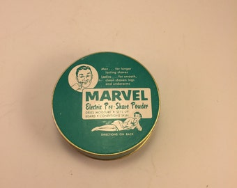 rare Vintage Marvel Tin with pinup girl.