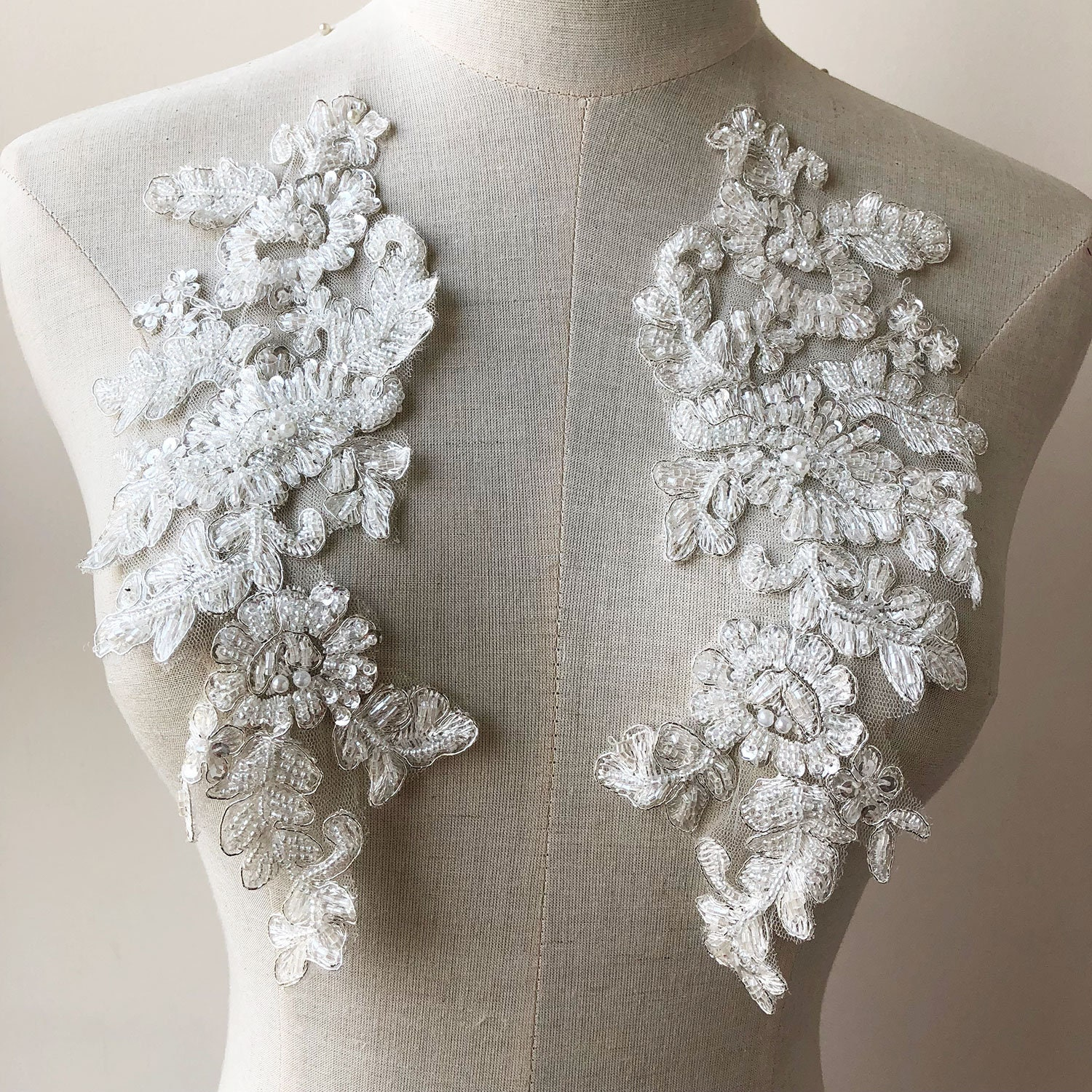 OFF-White Sequined Lace Applique Beading Lace Appliques Silver Corded Flower  lace Patches Embroidery Bridal Dress Addition Fringe 2pcs dcb50dd975b6