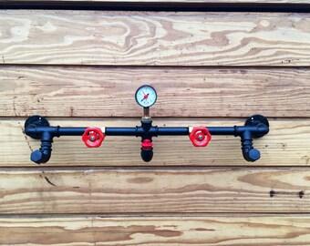 Industrial Steampunk Coat hanger/hanger in hydraulic tubes.