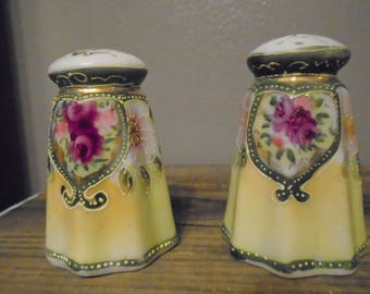 Antique vintage Nippon hand painted salt and pepper porcelain ceramic in green and yellow with pink floral design