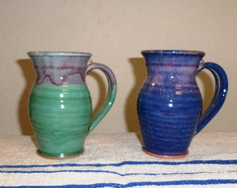 Two (2) handmade pitchers in blue hues