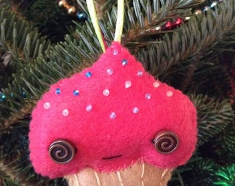 Bright Pink Frosted Yellow Cupcake Ornament With Multi Colored Sprinkles Swirl Eyes