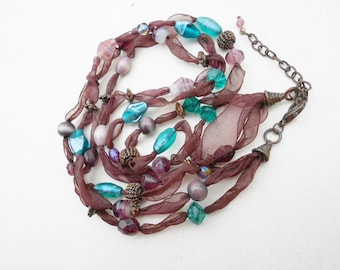 Vintage necklace 3 strands glass beads earth colors chocolates and earth blues