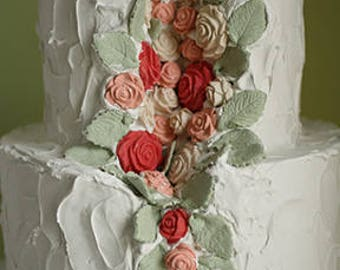 Faux cake photo shoot prop with a flower cutout section, two tier fake cake with pink and cream flowers. Country kitchen decoration