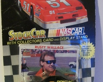 1991 Rusty Wallace Black Pontiac Excitement  #2 Racing Champions 1/64 Scale NASCAR Diecast Car New on Damaged Card