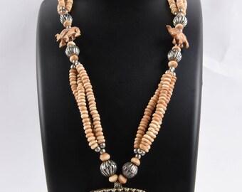 vintage carved bovine bone carved elephant and lion  boho  tribal necklace  lucky charm 26 inch #522