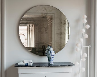 Frameless mirror 1920s inspired Art Deco glass hanging wall mirror with antique glass mirror and geometric style. Round hanging wall mirror.