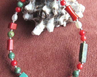 Bracelet with red coral, sponge coral, african turquoise, fresh water pearls, sterling silver accents and lobster claw,  7 1/2 inch length.