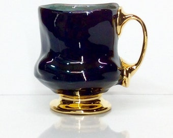 black mug with gold two finger handle