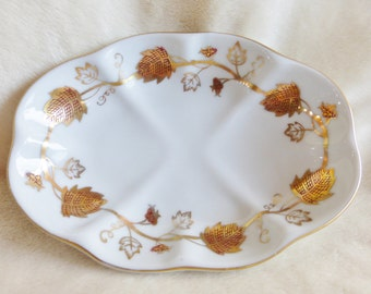 Small vintage soap or trinket dish in white porcelain with leaf design and 22k gold