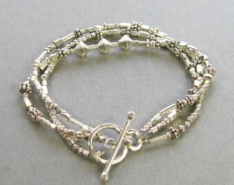 3 strand sterling silver asymmetrical beaded bracelet, 7 inch sterling beaded bracelet with toggle clasp