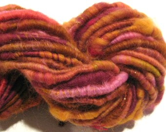 Super Bulky Handspun yarn Gypsy Glow 46 yards corespun art yarn orange pink gold burgundy knitting supplies crochet supplies doll hair