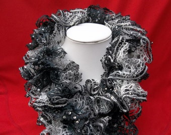 Fancy black, gray and white sequined scarf with ruffles