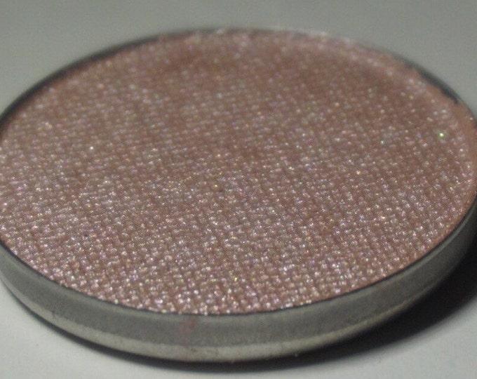 Sagittarius Pressed Eyeshadow - Semi Sheer Smokey Base with a Pinkish/Lilac Duochrome Shift