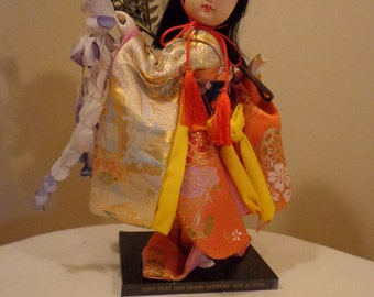 GEISHA DOLL, Japanese Dress 10 Inch on Black Stand Reads Toyo Seat USA Grand Opening Apr. 6 1990 Commemorative Doll, Asian Doll Glass Eyes