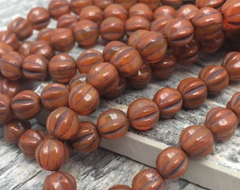 Czech Glass Melon beads 6mm. One unit has 25 beads. Color: Paprika with brown wash