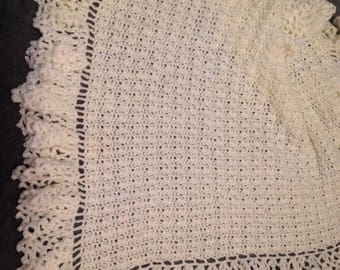 White baby afghan. 28x34