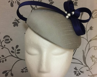 Silver button fascinator with blue flower detail