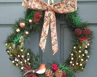 Winter Christmas Wreath with pinecones ,a large burlap holly and red berry bow, mistletoe, a robin, bells, berries and extra glitter!