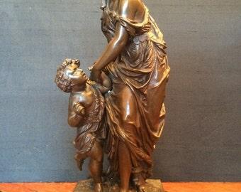 E Heber - Woman with child bronze statue