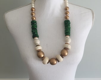 Mid length gold, white and green necklace