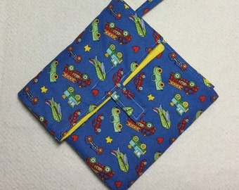 flip and go travel diaper changing pad/baby changing pad/travel diaper clutch with pockets: trucks, planes, cars, trains on blue with yellow