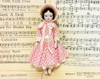 "1940s Ruth Gibbs 7"" China Doll in Pink Pattern Dress and Felt Hat/Small Vintage China Doll with Gold Painted Shoes"